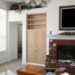 Two sets of doors hide the clutter of audio/video equipment and the television.