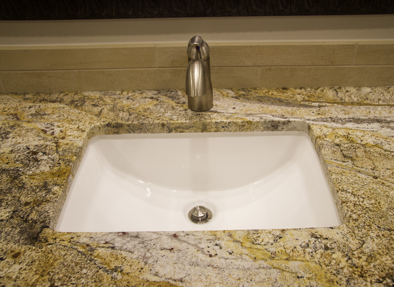 We just love the modern look of this barrel shaped undermount sink.